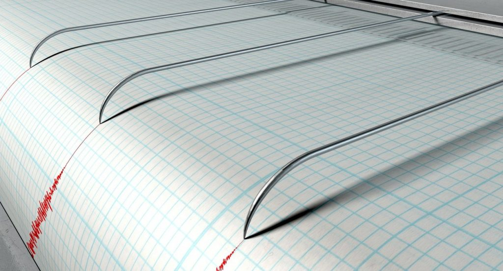 Seismograf care înregistrează mișcările Pământului.