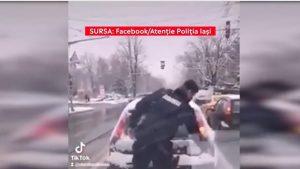 """Un jandarm a curățat zăpada de pe luneta unui mașini din trafic. Reacțiile apărute: """"Șoferul trebuia amendat"""""""