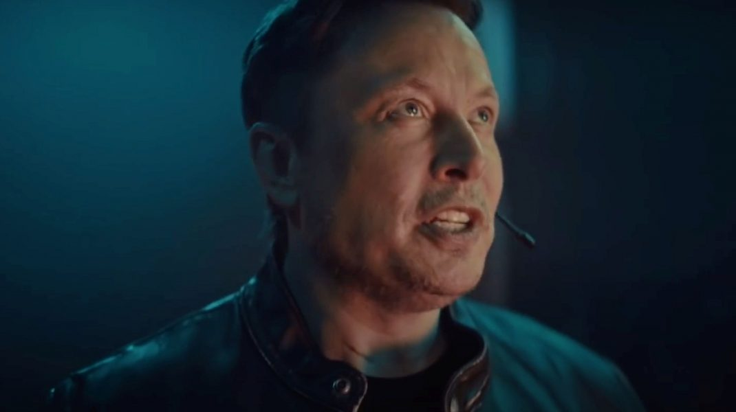 O poză cu Elon Musk care se uită în sus.