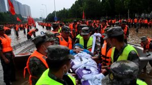 Rescue team are busy helping trapped residents to move to safe area, after Fanpo Village are badly hit by the historical flood in Liuhe Town of Xingyang City, central China's Henan Province, 22 July 2021.