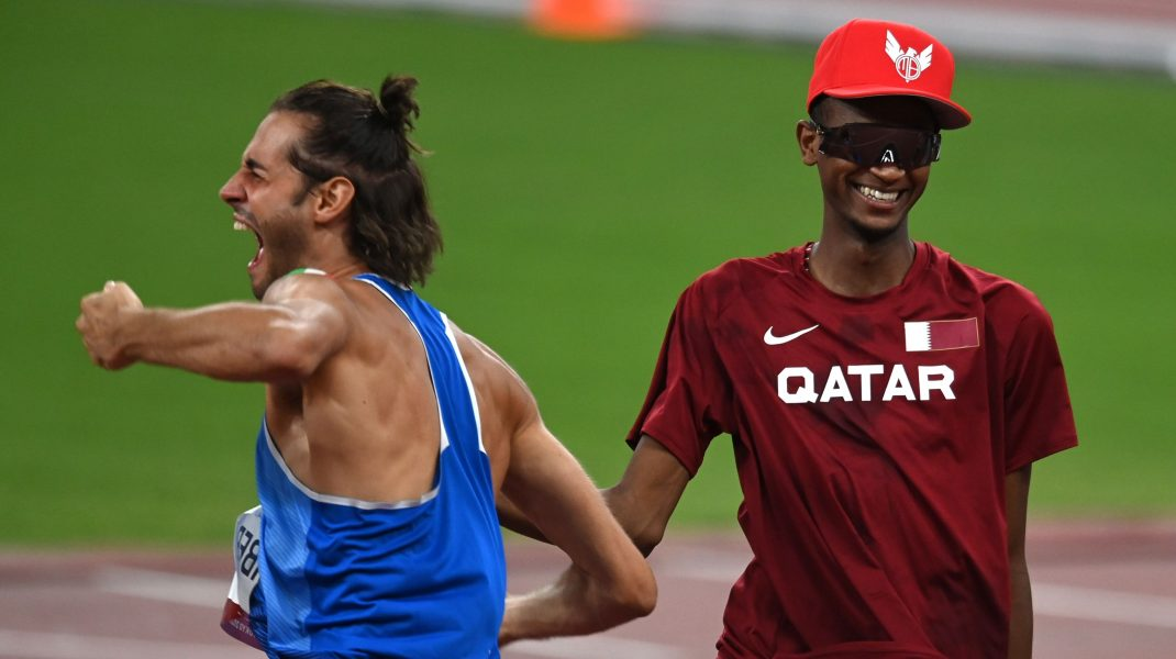 6614759 01.08.2021 Italy's Gianmarco Tamberi, left, and Qatar's Mutaz Essa Barshim celebrate after winning gold medals during the men's high jump final at the Tokyo 2020 Olympic Games at Shiokaze Park in Tokyo, Japan. Grigory Sysoev / Sputnik